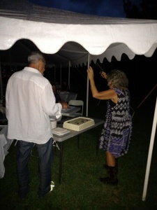 Woody Tasch and Carol Peppe Hewitt cut the Slow Money NC cake Saturday night